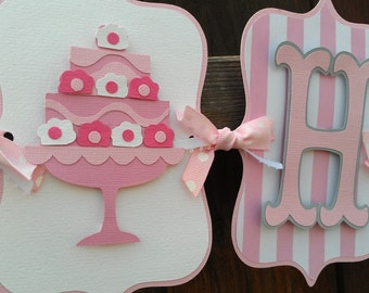 Cake Happy Birthday banner in shades of pink and white.  Sweet treats birthday