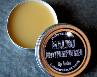 Malibu Rum. Malibu. Malibu Rum Lip Balm. .5 oz / 14 g. Rum & Coke Lip Balm. Natural Lip Balm. Funny Lip Balm. Beeswax Lip Balm.