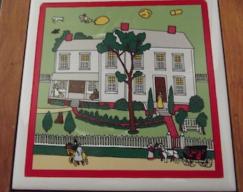 Wood framed ceramic tile trivet shows quaint colonial farming scene in bright colors