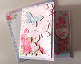 Flowers and butterflies sympathy card with matching envelope.