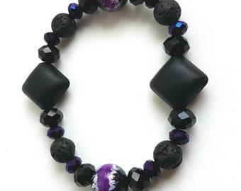 Lava stone, black, and purple beaded bracelet