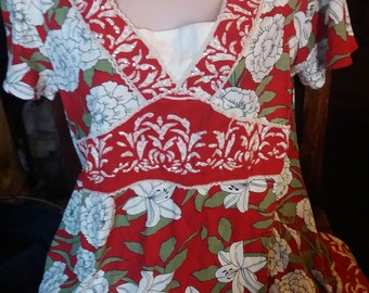 unusual red and white top with a kind of alpine feel
