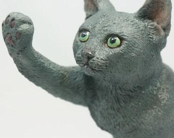 Consensus(Russian Blue cat figurine)