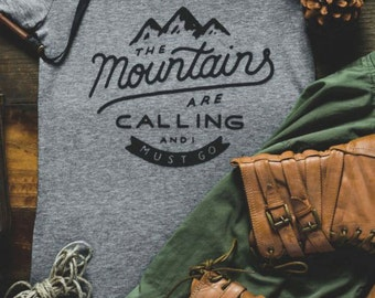 MOUNTAINS Are Calling And I Must Go ladies t-shirt