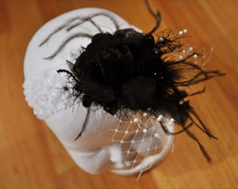 Black and white headband with black flower, feathers and Russian netting