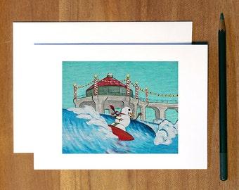Holiday Cards. Christmas Cards. Coastal Christmas Cards. Ripping Snowman. Blank Folded Card. Waves.
