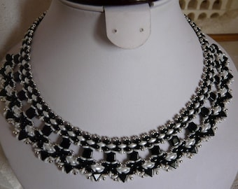 Trendy woven with black and white pearls NECKLACE
