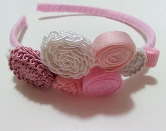 Headband with various trimmings and ribbons swivels