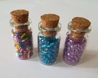 Set of 3 vials of beads blue, purple, multicolor