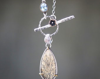 Tiny Dendritic quartz pendant necklace set in silver bezel and brass prongs setting with blue topaz on the side on oxidized silver chain