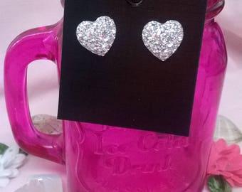 Silver heart stud earrings.