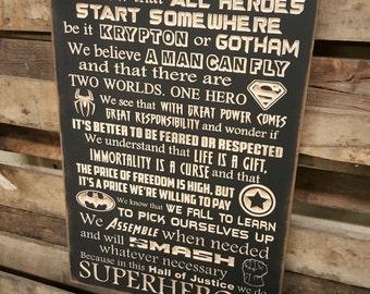 "Custom Carved Wooden Sign - ""SUPERHEROES - In this house we do - Superhero, Batman, Superman, Spiderman, Avengers, Captain America"""