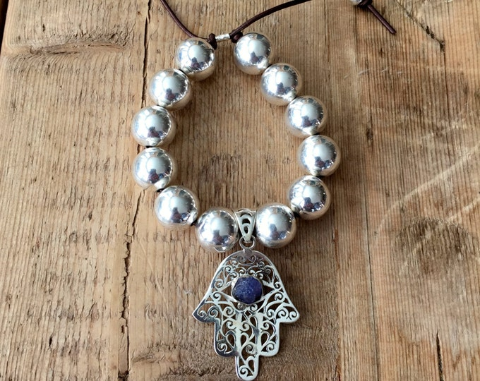15mm Sterling Silver Ball Bracelet with Sterling Silver Hamsa Hand with a Rough Tanzanite stone