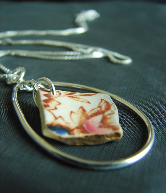 Sea Keeper sea pottery necklace with floral design