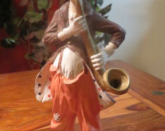Adorable  Vintage Porcelain Clown Figurine Playing Sax