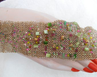 Unique, woven bracelet made of different beads.