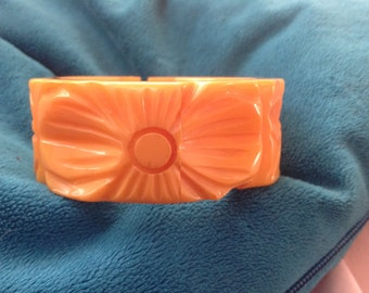 Vintage carved butterscotch Bakelite clamper bracelet with floral design