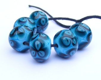 Teal flower bead set of 6 lampwork beads in turquoise, deep green and blue