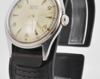 Kimberly vintage wrist watch, 17 Jewels, heavy stainless steel round water resistant case, leather cuff band