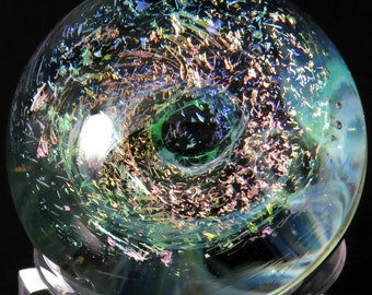 Multicoloured copper with green mist spiral galaxy over a nebula glass marble - collectable handmade space marble glass artwork