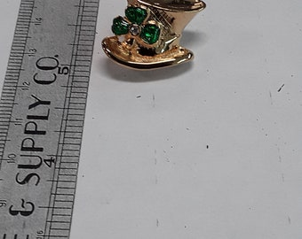 Gold toned pin brooch top hat with shamrock green and white used