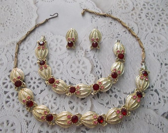 A Beautiful Vintage Gold tone Cast Metal Necklace with Red and Pink Rhinestones Shell like Design with matching Bracelet and Earrings