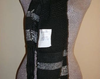 This Saori inspired handwoven scarf is made from black and white yarns, and threads. It is made by a Canadian Weaver.