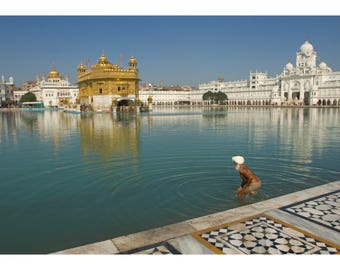 Photograph of a pilgrim bathing at the Golden Temple of Amritsar, India - Fine art archival photographic print by Steve Davey