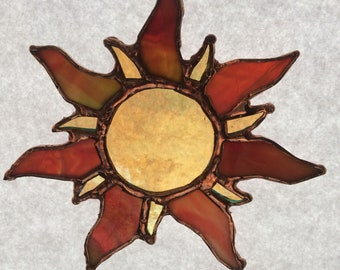 Sun in stained glass and lead solder.