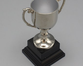 Silver Plated Small Trophy Award on Black Plastic Stand