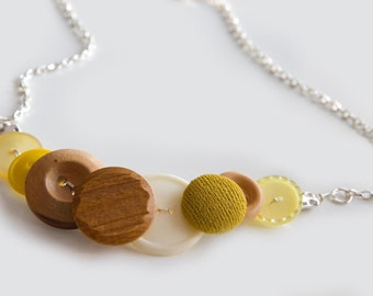 Vintage mustard yellow and pinewood button necklace.