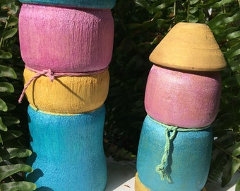 Garden gnomes-  adorable and whimsical. Delightful pastel colors  . Turned on a wood lathe .