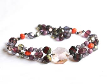 The Choker necklace with purple glass beads and black wire