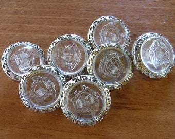"8 Clear with Hawaiian Face Round Shank Buttons Size 11/16""."