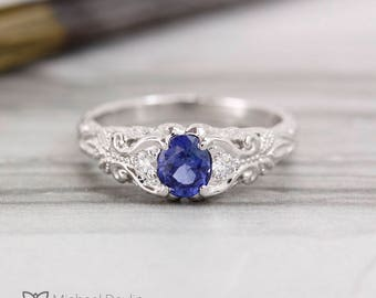 Oval sapphire scroll ring