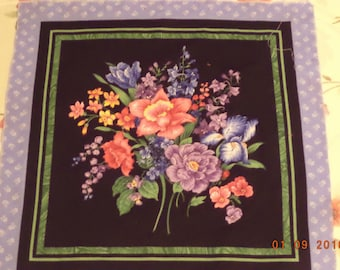 Fabric pillow top panel with spring bouquet of colorful flowers set against black