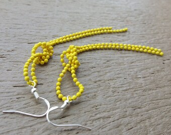 Yellow knot statement earrings