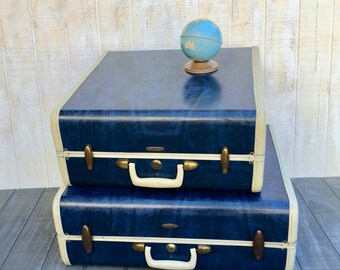 A Pair of Vintage Midcentury Navy Blue Samsonite Suitcases
