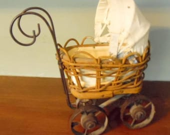 small, vintage wicker doll buggy, with metal handle and wheels, baby doll accessories, baby doll stroller, doll buggy, doll accessories