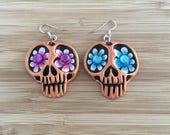 Skull earrings with flowe...