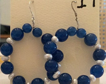Hoop earrings of blue onyx and cultured pearls and sterling silver hooks.