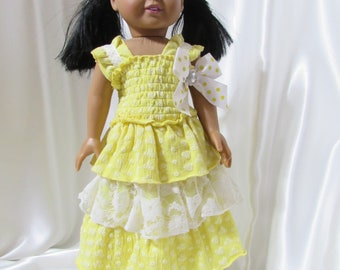 """Yellow elastisized knit dress for 18"""" dolls, perfect for a picnic or birthday party."""