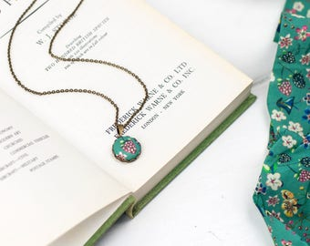 Strawberry necklace featuring teal liberty fabric covered button