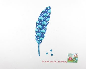 Applied fusible fabric feather Petit Pan blue flex glitter patch iron on fusible feather pattern liberty coat