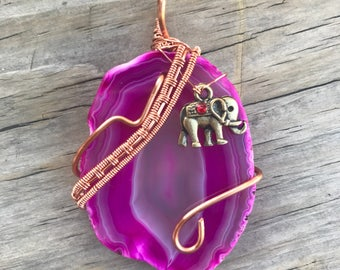 Polished agate slice wire wrapped with copper wire