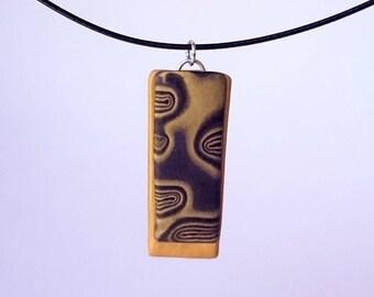 Black and gold rectangle pendant_unique handmade mokume gane polymer clay jewellery