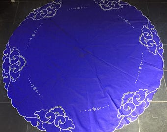 A pretty, vintage, large circular tablecloth in blue and white with cutwork and embroidery.