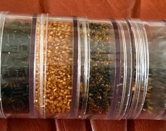Six Containers of Seed Beads, Clear, Black, Gold, Brown Mix and Black and Clear Mix