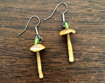 set of two porcelain hypholoma mushroom earrings in yellow and beige
