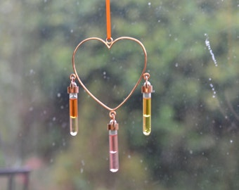 Heart Shaped Copper Suncatcher Window Hanger with hand blown glass Vials with coloured oils